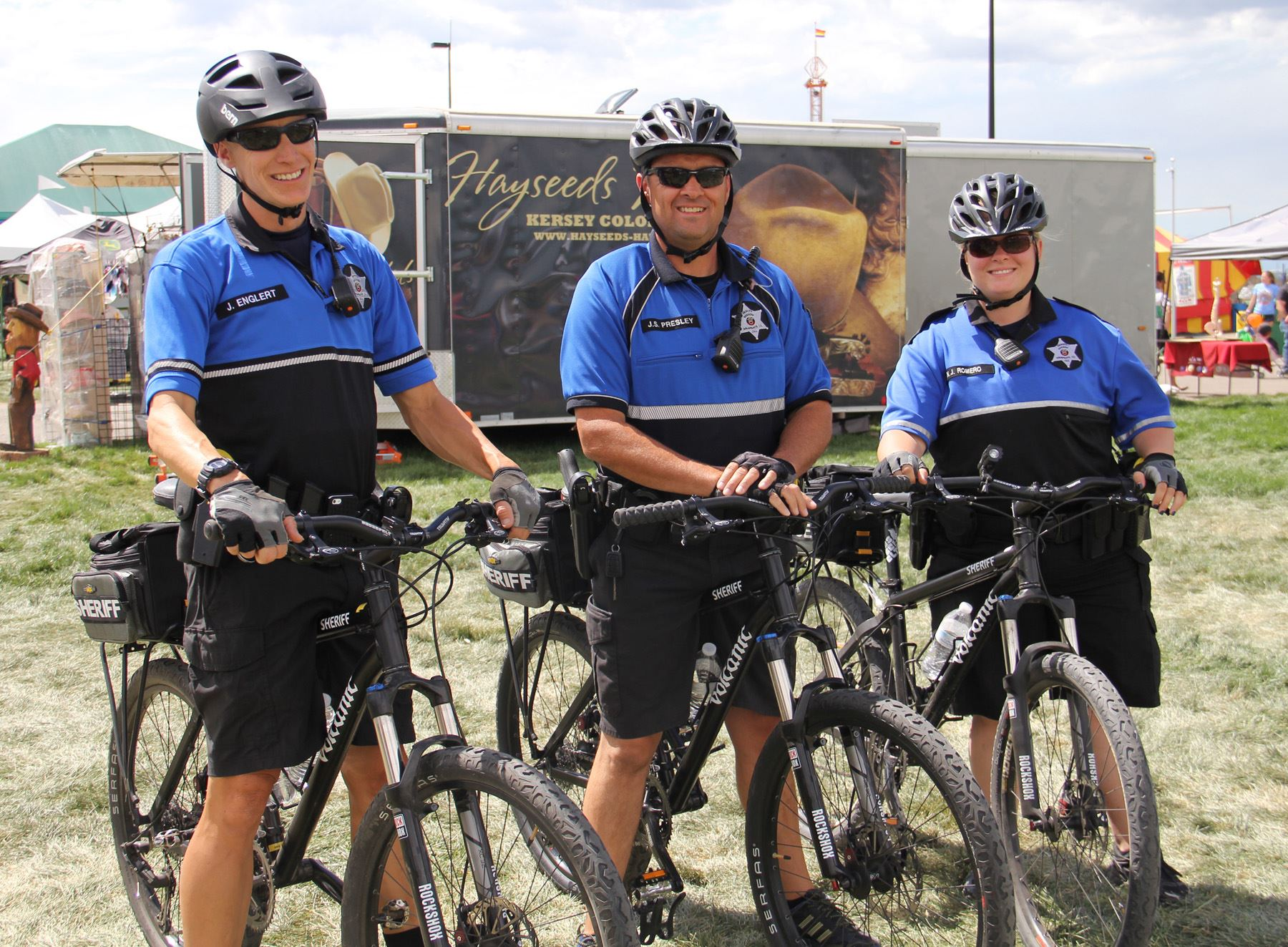 Three bicycle deputies standing with bikes